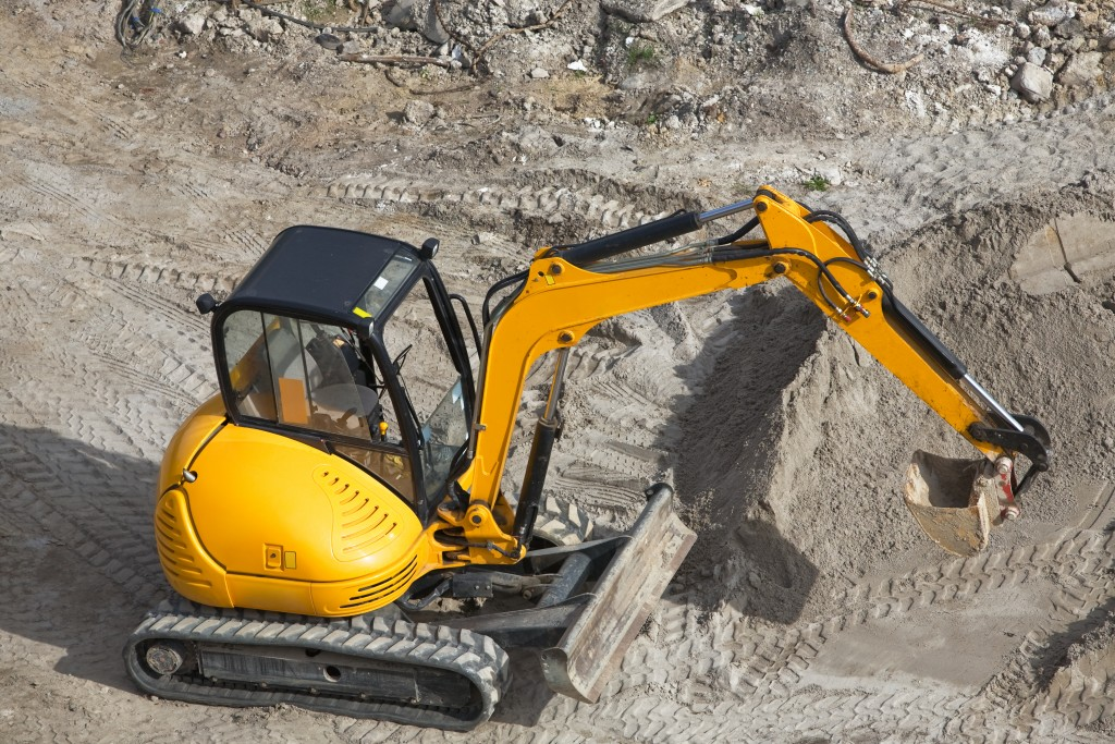 High Angle View of a Yellow Mini Excavator