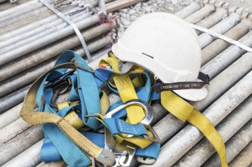 Safety harness and helmet at construction site - iStock_000063264039_Medium