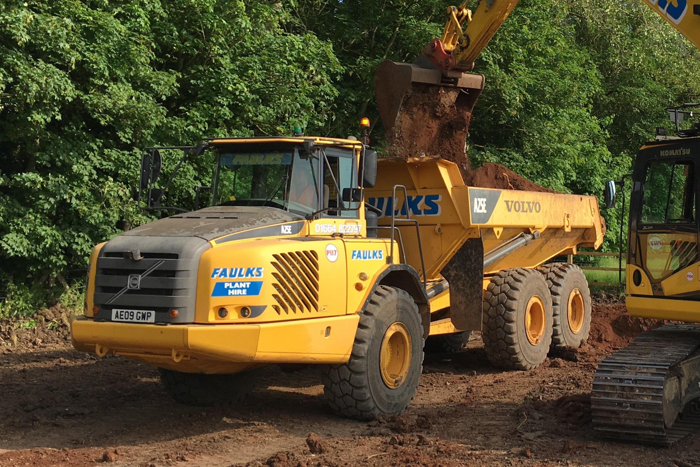 A Volvo A25E dump truck hired from AE Faulks being filled with excavated soil