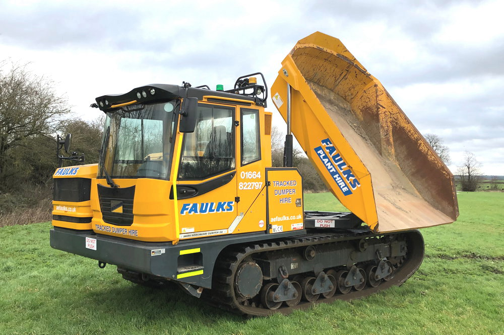 The Bergmann 4010R tracked dumper in field with dumper loader tipped. This tracked dumper is available to hire from AE Faulks today