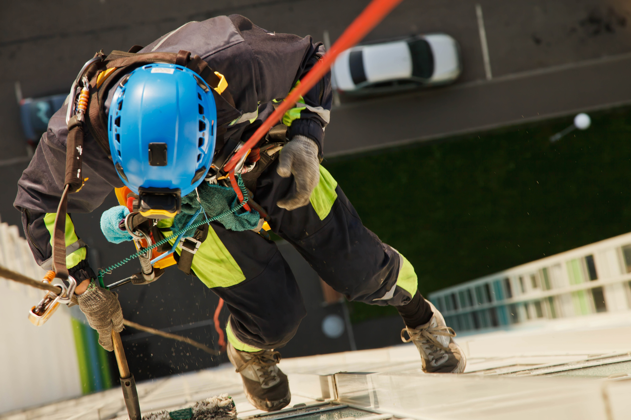 men working in the high with harness